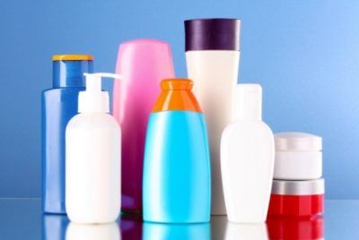 bottles of health and beauty products on blue background